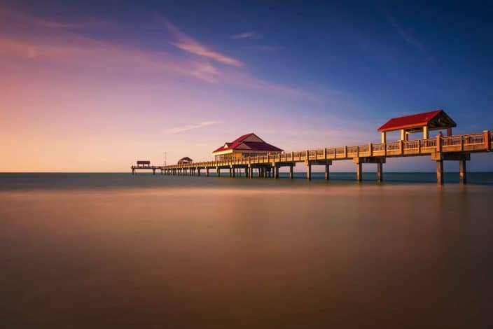 Pier 60 at sunset on a Clearwater Beach in Florida. Long exposure.