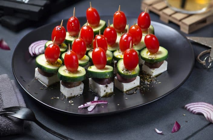 salad skewers with feta cheese, tomatoes, olives, and cucumber