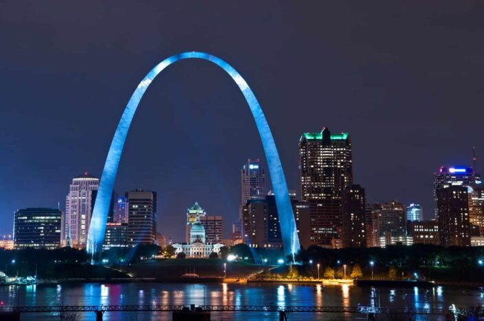 View of the glowing skyline, large arc sculpture, and skyscrapers in Bay St.Louis, Mississippi.