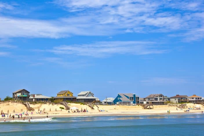beach with cottages at Nags Head in the Outer Banks perfect for a family vacation