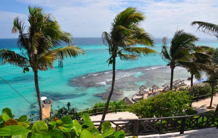 Isla Mujeres with Palm Trees overlooking the turquoise water, one of the best beaches in Mexico