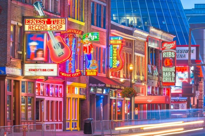 Honky-tonks lit up with neon lights on Lower Broadway in Nashville, Tennessee