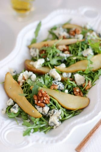 pear and blue cheese salad on a long white plate