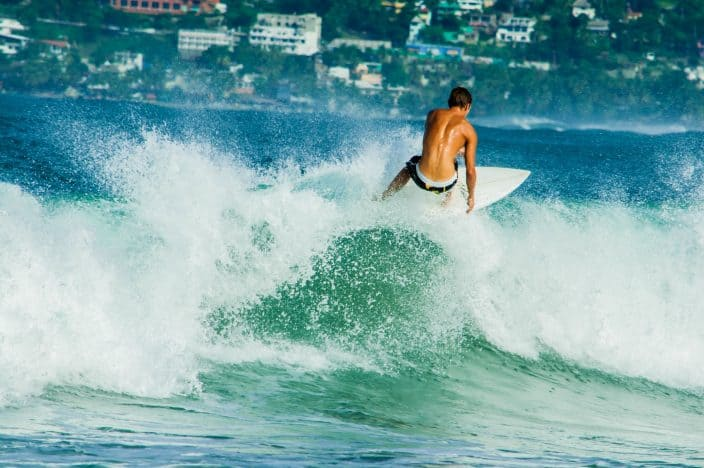 surfing in Puerto Escondido, one of the best beaches in Mexico