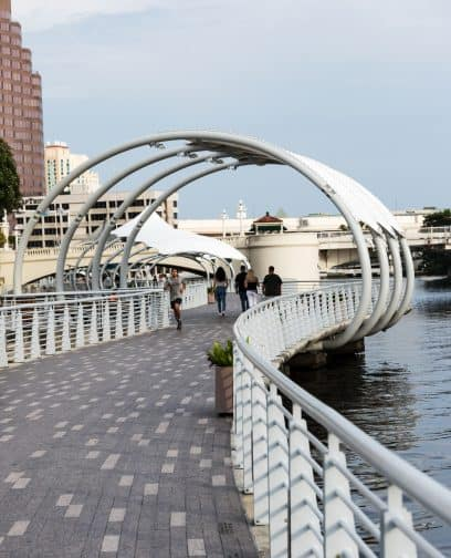 The Tampa Riverwalk with people running and walking
