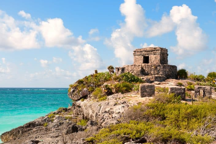 Mayan ruins on a cliff overlooking the water in Tulum, one of the best beaches in Mexico