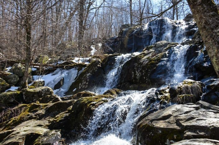 Springtime at Dark Hollow Falls, a waterfall located within Shenandoah National Park in Virginia along Skyline Drive in the Blue Ridge Mountains, an adventure vacation location