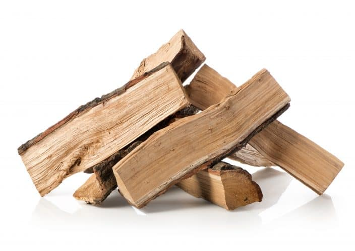 a pile of firewood isolated on a white background, a camping essential
