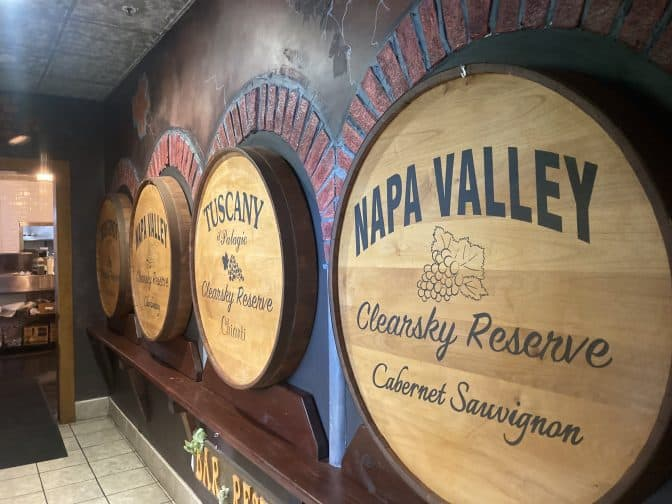decorative wooden barrels of wine at Clear Sky restaurant on the walls with brick