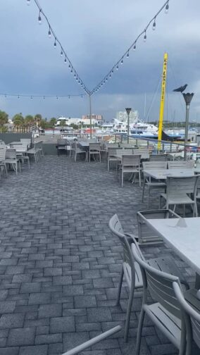 the rooftop at Marina Cantina with grey skies, tables and chairs, an example of things to do in Clearwater Beach